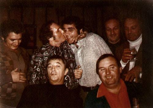 Howie Winter, Whitey Bulger's rival inside the Winter Hill King, kissing criminal-turned-actor Alex Rocco, with Robert Mitchum in the front at left. (Photo courtesy Howie Carr/Emily Sweeney.)